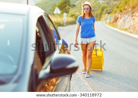 Woman with a yellow suitcase goes to a car parked on the roadsid Stock photo © vlad_star