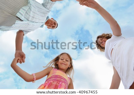 Stock photo: Happy family with little girl against sky, foreshortening from b