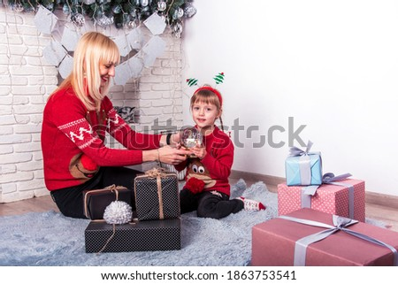 Mother and daughter consider Christmas decorations. Red and whit Stock photo © Paha_L