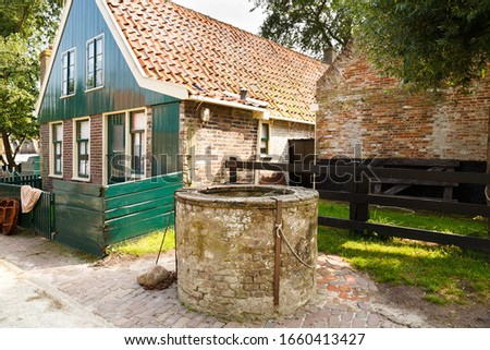 typical old fishermans brick building in the village of Harlinge Stock photo © meinzahn