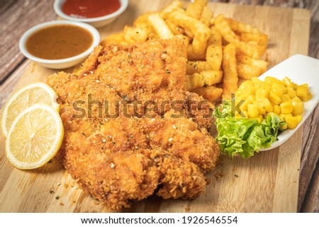 chicken cutlets and potatoes with vegetables on a wooden backgro stock photo © yatsenko