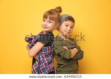 Cute confident little caucasian boy in checkered shirt in sunglasses fooling listening to music in h Stock photo © Traimak