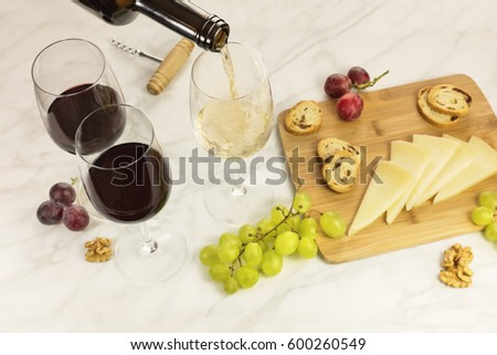 Glass of white wine with green grapes on marble board with corkscrew opener and cork on black backgr Stock photo © DenisMArt