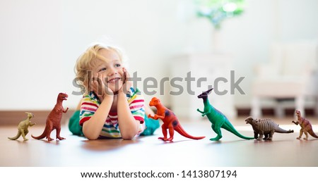 happy kids with toys at home Stock photo © dolgachov