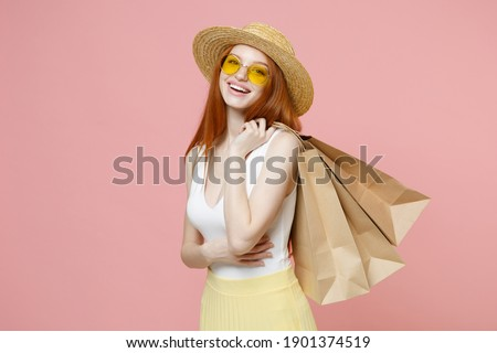 Image of shopper woman 20s in straw hat holding colorful paper s Stock photo © deandrobot