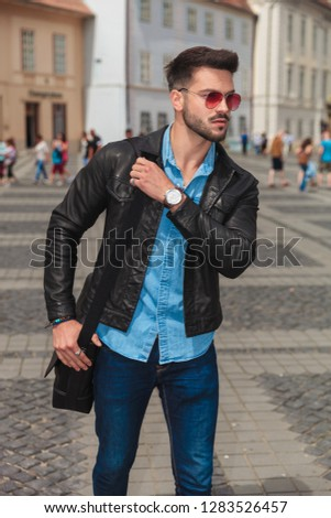 curious fashion man with red sunglasses going sightseeing the ci Stock photo © feedough