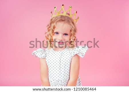 Little girl with a crown on her head on a white background. Birt Stock photo © dashapetrenko