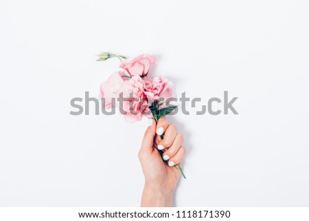 Beautiful women's hands with trendy manicure holding lovely peach crossbag. stock photo © studiolucky