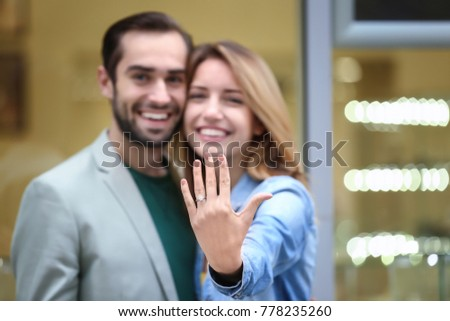 Man showing to beautiful girlfriend an engagement ring during romantic picnic Stock photo © Kzenon