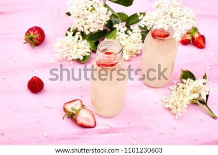 Kombucha tea with elderflower and strawberry on pink background. Stock photo © Illia