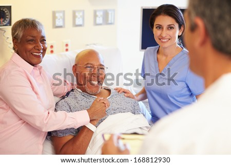 Happy Smiling Doctor or Nurse Talking to Senior Woman in Chair A Stock photo © feverpitch
