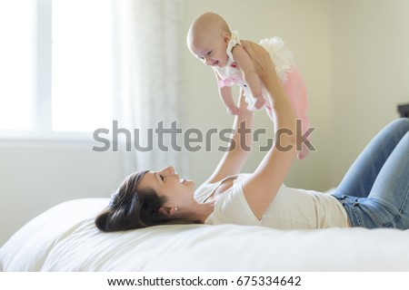 Portrait of mother with her 3 month old baby in bedroom Stock photo © Lopolo