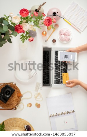 Top view of hands of mobile customer searching and adding goods in basket Stock photo © pressmaster