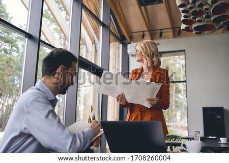 Pretty fashion designer and her colleague looking through color swatch set Stock photo © pressmaster