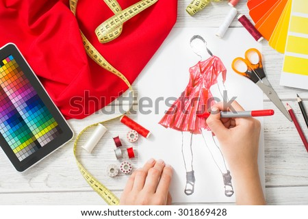 Stock photo: professional Fashion designer working of drawing sketches projec