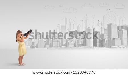 Cute nina mirando grande colorido ciudad Foto stock © ra2studio