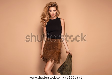 Portrait of a young happy beautiful brunette woman in warm cloth Stock photo © dashapetrenko