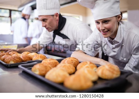 Male and female chefs preparing kaiser rolls in kitchen at hotel Stock photo © wavebreak_media