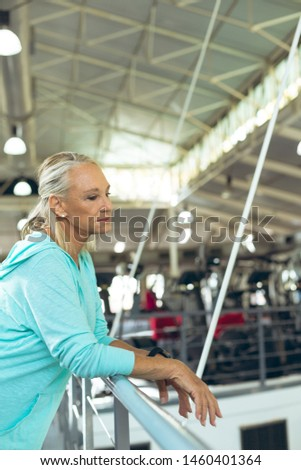 Side view thoughtful senior woman leaning on a railing at beach Stock photo © wavebreak_media