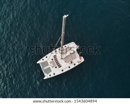 Directly from above view white lonely modern catamaran in calm w Stock photo © amok