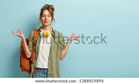 Hands of restful female with smartphone waiting for uploading of website page Stock photo © pressmaster