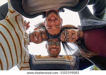 Low angle view of multi ethnic group of friends forming huddle with heads  on beach  Stock photo © wavebreak_media