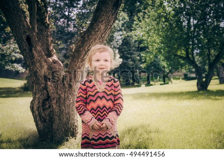 Woman and child 3-5 years old in pink dresses in agricultural field with flowers Stock photo © ElenaBatkova