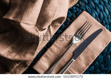 Holiday table setting with beige napkin and silver cutlery, food Stock photo © Anneleven