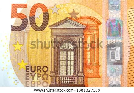Fifty euro banknotes close up on light background. European union money Stock photo © DenisMArt