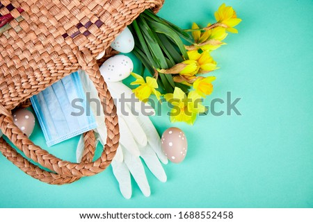 flat lay of narcissus flowers in near protective medical masks stock photo © illia