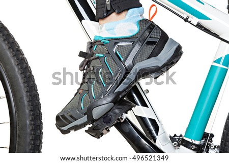 Female foot in white shoe on the pedal of the bicycle Stock photo © Nobilior