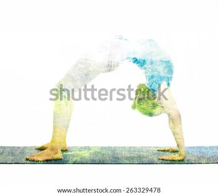 woman doing Ashtanga Vinyasa Yoga asana Dhanurasana - bow pose Stock photo © dmitry_rukhlenko