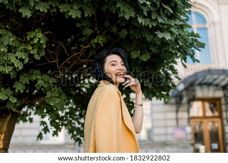 Portrait of pretty young businesswoman sitting outdoor at cafe a Stock photo © HASLOO