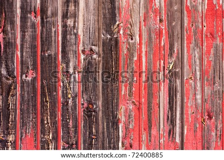 An old worn barn or antique wooden fence with chipped red paint. Stock photo © inxti
