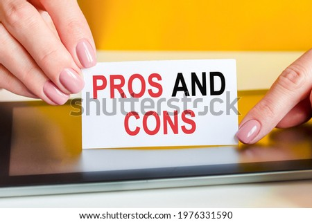 hand is writing pro and contra on paper stock photo © juniart