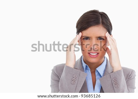 Close up of tradeswoman experiencing a headache against a white background Stock photo © wavebreak_media