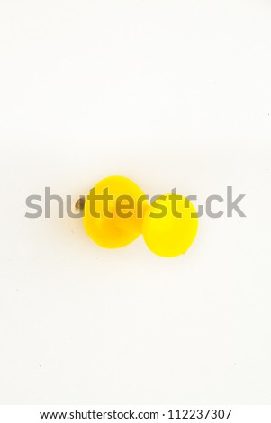 Close up of a yellow pushpin pierced in the wall against a white background Stock photo © wavebreak_media