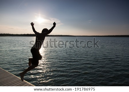 silhouette of a man diving in a bay georgian bay tobermory on stock photo © bmonteny