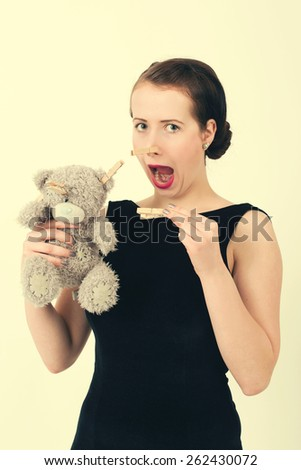 attractive smiling brunette holding teddy bear grimacing with pe Stock photo © artush