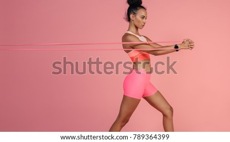 Sportswoman exercising with a resistance band. Black and white photo Stock photo © restyler