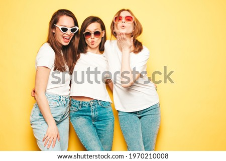 Sexy brunette woman in white shirt and jeans Stock photo © arturkurjan