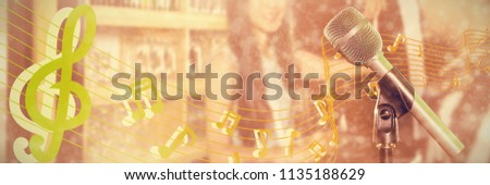 Close-up of microphone  against smiling woman holding beer mug at nightclub Stock photo © wavebreak_media