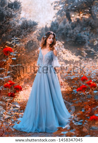 Fabulous girl in a red dress standing in the garden with hearts  Stock photo © Alones