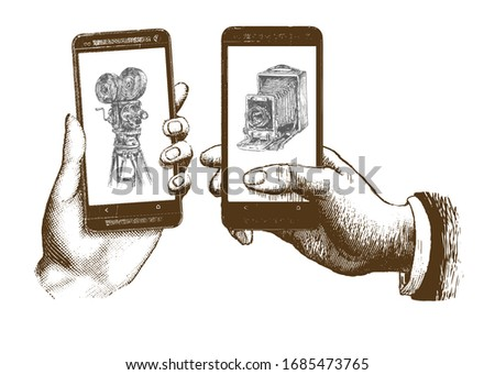 Old retro film camera and modern smartphone on black background Stock photo © dash