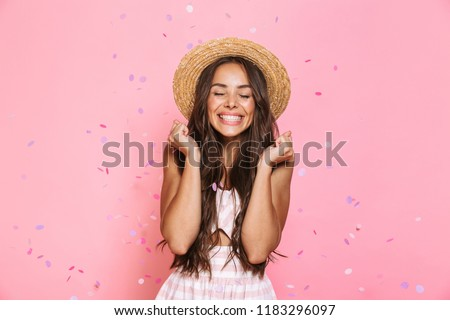 Photo of pretty woman 20s wearing straw hat laughing while stand Stock photo © deandrobot