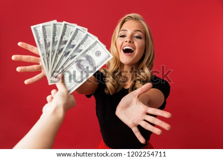 Mulher olhando dinheiro alguém isolado vermelho Foto stock © deandrobot