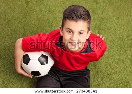 gyermek · ül · futballabda · futball · pálya · gyerek - stock fotó © matimix