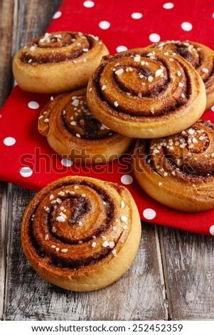 Sweet cinnamon bun on wooden table Stock photo © furmanphoto