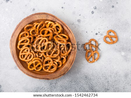 Hard salted pretzels classic snack for beer in wooden bowl on wooden background. Stock photo © DenisMArt