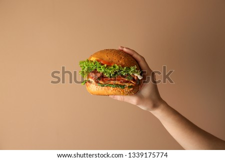 Woman Holding Burger In Hand Stock photo © AndreyPopov
